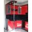 Угловая кухня из красного пластика Acryline с барной стойкой
