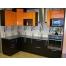Угловая оранжево-черная кухня из пластика Acryline